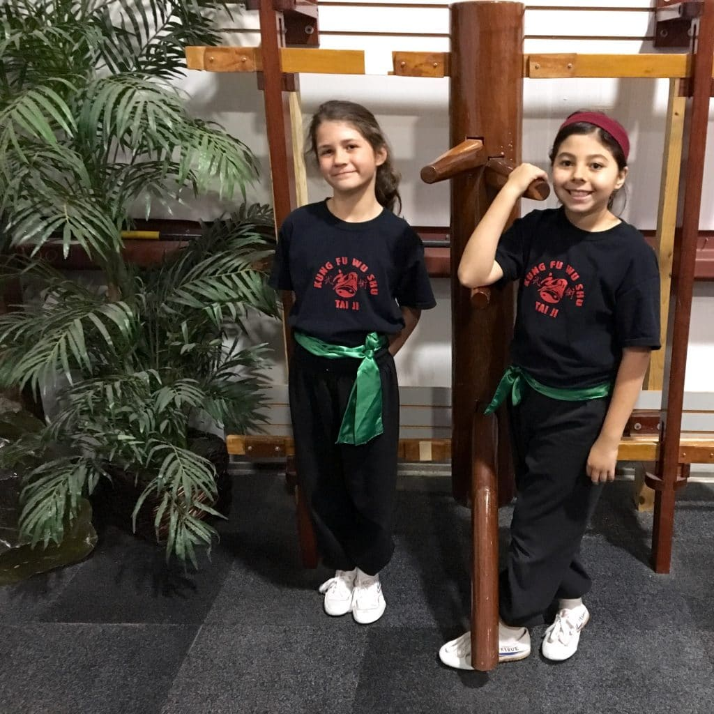Enter Shaolin'a Cara and Jaya after getting their Wushu green belt!